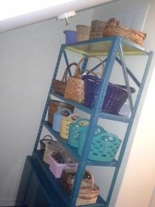 Wall shelf filled with an assortment of baskets