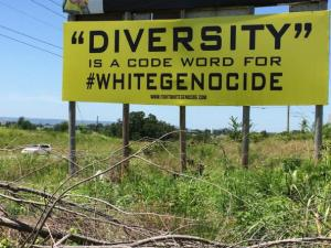"Billboard that reads ""'Diversity' is a code word for #whitegenocide"" on Highway 412 in Arkansas.  I saw the billboard personally, but the picture is from an article on ""White GeNOcide Project"" written by Steve Goode and posted on July 14, 2015.  I didn't see a photo credit on the article itself. http://bit.ly/1N1eKW9"