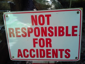 "Sign that reads, ""Not Responsible for Accidents"""