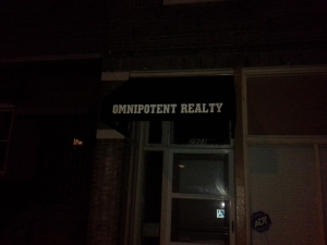 Sign over a business named Omnipotent Realty
