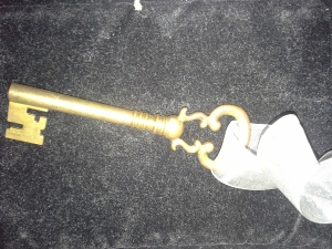 Old-fashioned key attached to a ribbon