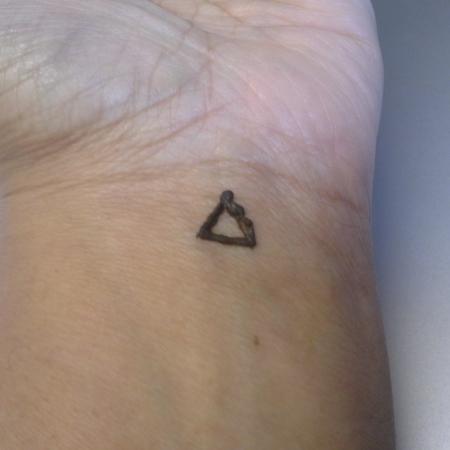 Henna triangle on the inside of my wrist