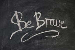 """""""Be Brave"""" on a chalkboard by geralt on Pixabay at https://pixabay.com/en/board-slate-blackboard-font-939244/"""