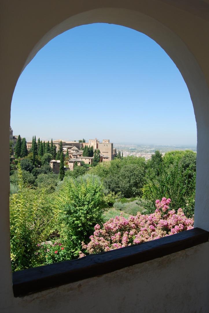 Scene of Granada through window by pcdazero on Pixabay at https://pixabay.com/en/granada-alhambra-spain-park-window-471751/