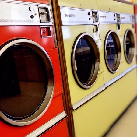 Machines in a laundromat by Wokandapix on Pixabay at https://pixabay.com/en/laundromat-washer-dryer-machine-928779/