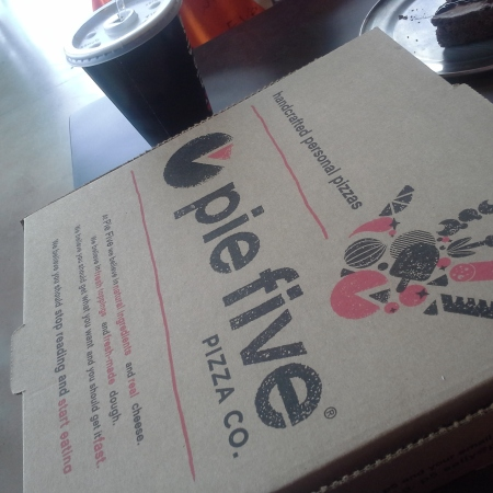 To-go box from Pie Five Pizza