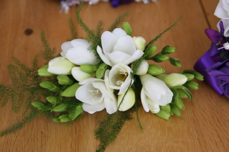 White corsage by foristlution on Pixabay at https://pixabay.com/en/white-corsage-freesia-374184/