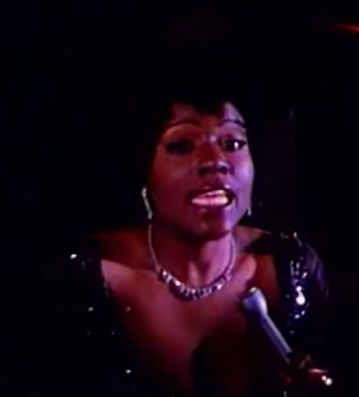 "Gloria Gaynor - still from ""I Will Survive"" video on Youtube at https://www.youtube.com/watch?v=fCR0ep31-6U"