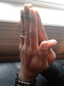 Chris' hands in prayer
