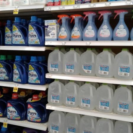 Bottled water in detergent aisle at grocery store